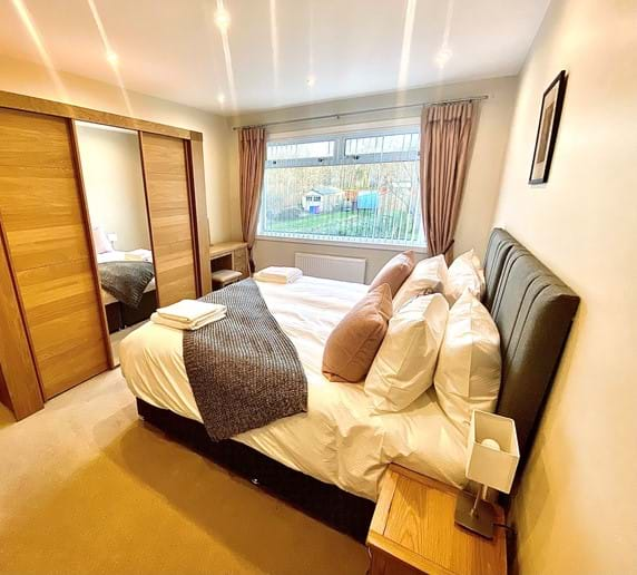 Ground floor super king room with triple wardrobe, dressing table and large chest of drawers
