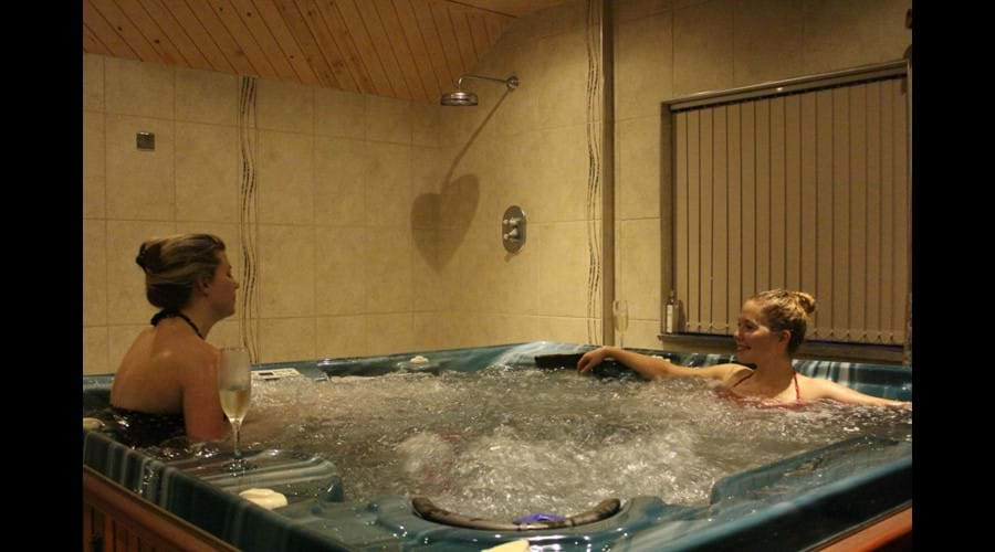 Relax in the indoor hot tub