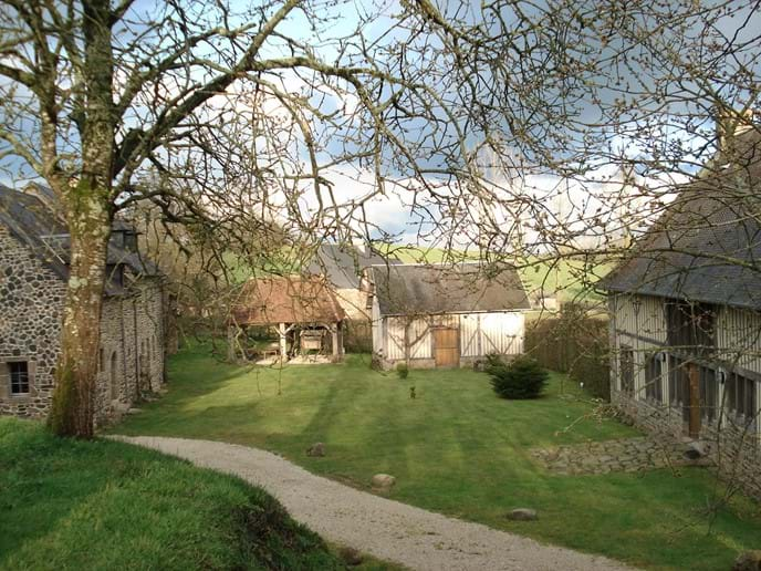 Boudet from the parking area showing The Farmhouse to the left, Barn to the right and Cider Press in the centre