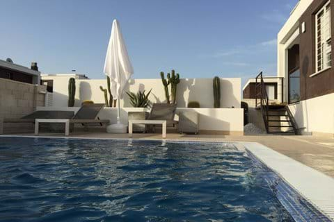 Poolside loungebeds overlooking 10 x 5 m private pool
