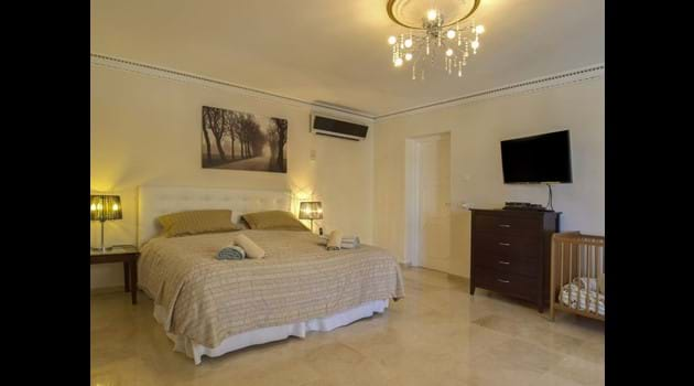 Bed 1 with  super king size bed + en-suite + cot with patio access too