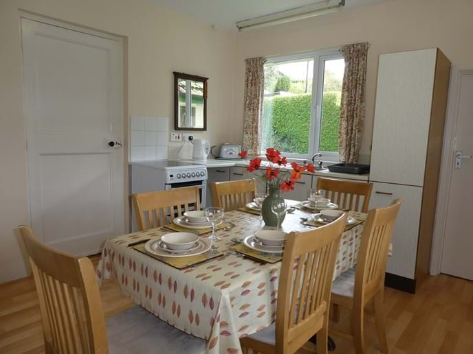 Large kitchen with dining table for six people