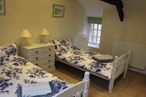 Twin bedroom with original exposed beams