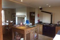 Bespoke wooden kitchen with Aga