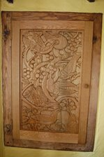 The hand carved oak cupboard in the lounge