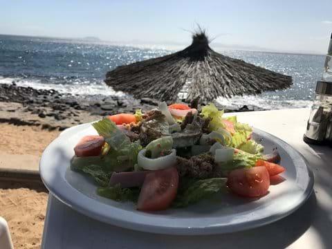 Lunch - Ensalada Chiringo at the local beach bar with views to Fuerteventura