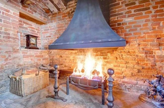 Roaring fire in an open Ingle Nook Fire Place in The Three Black Birds Holiday Cottage