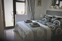 Bed 2- double bed with en-suite shower/toilet + cot- own patio access from the pool