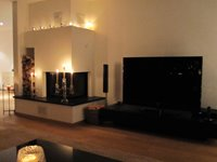 Fireplace and 52 Inch Flat Screen HD TV with English Channels