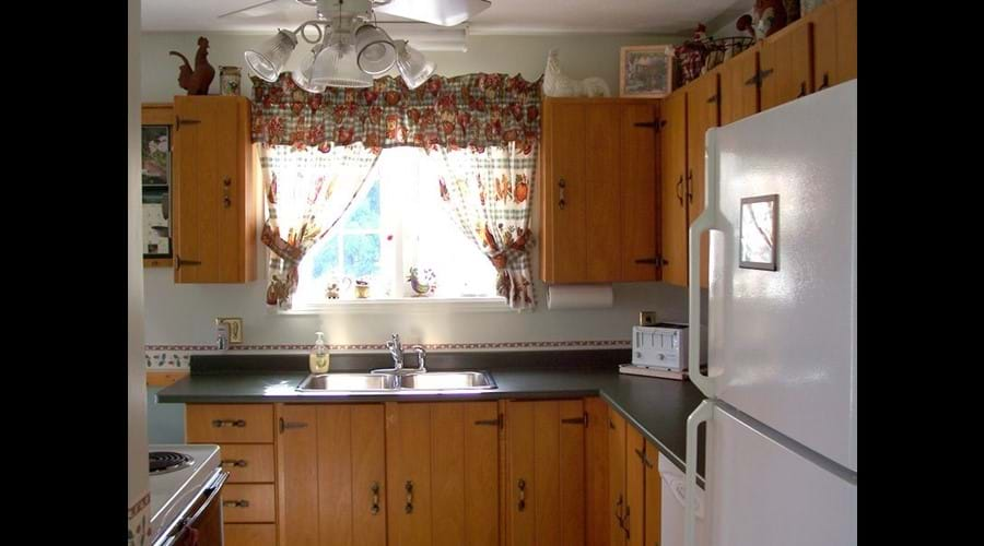 The kitchen is light and bright and located just a few steps from the dining room.