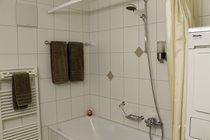 Modern bathroom with washer/drier