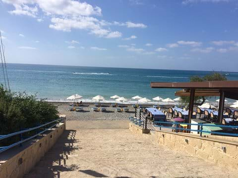Pissouri Bay Beach, relax on a sun lounger then cool off in the sea.
