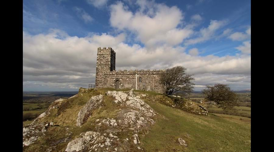 The Church of St. Michael de Rupe (St. Michael of the Rock), Brentor, is an iconic 12th century church on top of the Tor, visible for miles around. The views from the church are fantastic.