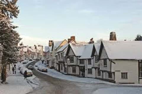 Lavenham  snowy winter Scene looking from Church Street to the High Street