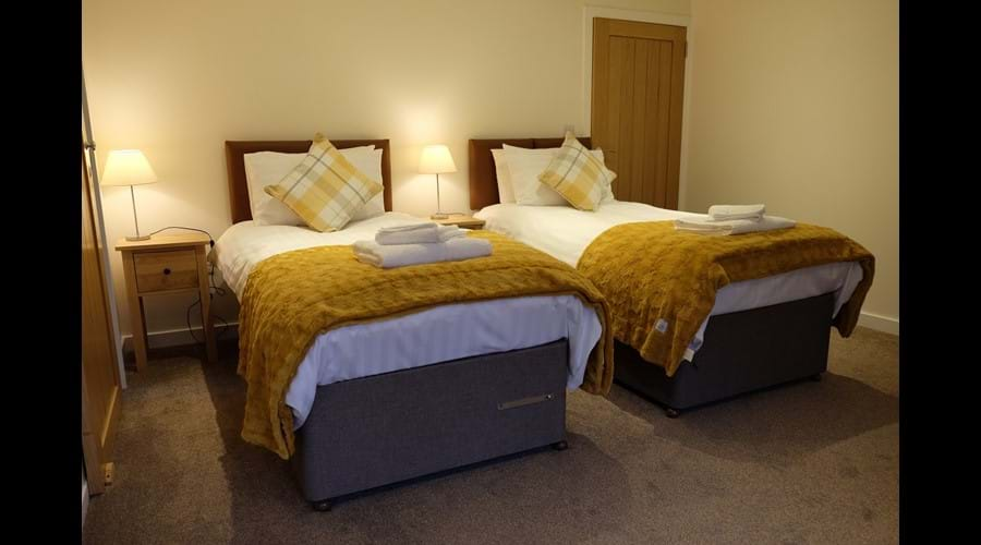 The larger bedroom can also be configured with two, full-sized single beds.