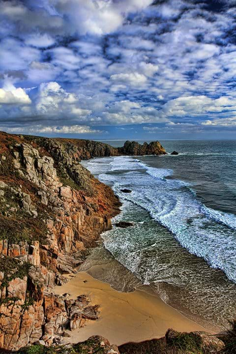 Pedn Vounder Porthcurno looking towards Logan Rock Cornwall