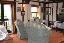 The Hayloft lounge double doors open, with view over the courtyard