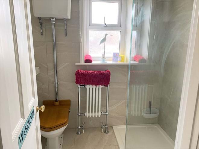 Bathroom on the first floor with large walk in shower