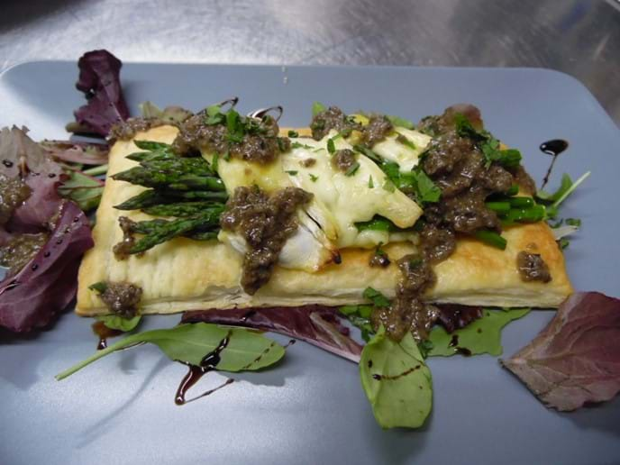 Asparagus Tart with Brie and a Black Olive Dressing.