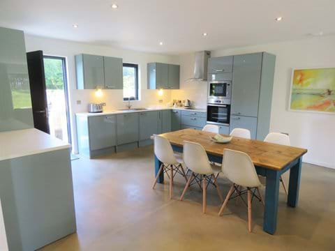 Bright contemporary well equipped kitchen and dining area in Sienna