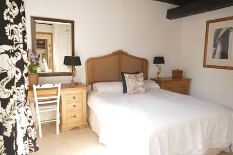 Bedroom Two in Le Chataignier is located on the first floor and has a king size bed
