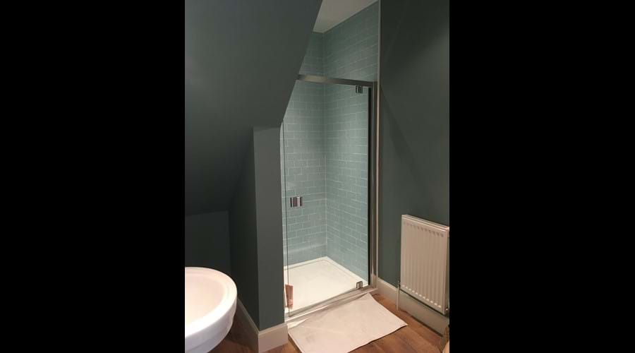 The walk in power shower room is adjacent to the third double bedroom.