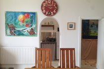 Dining table, archway to kitchen, doorway to internal hall leading to bathroom and bedroom