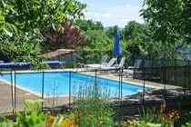 Heated pool and gardens at La Caze Gites