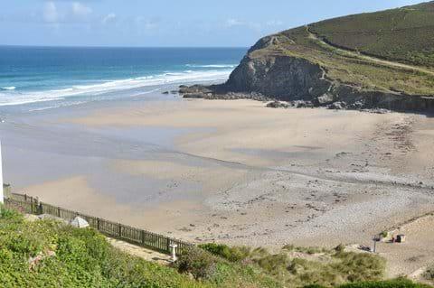 Porthowan beach with the south west coast path on the cliff.