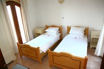 Second bedroom with twin beds and two juliet balconies