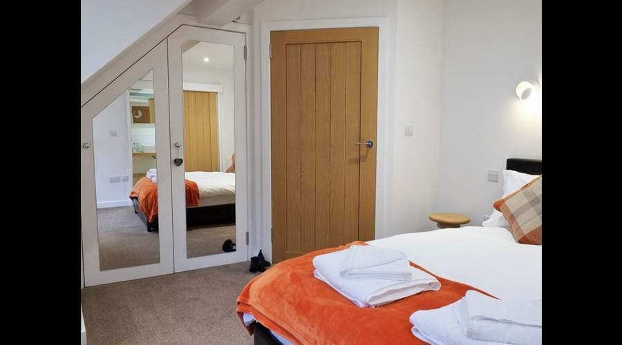 The double room has wall-mounted, over-bed reading lights and bed-side USB charging points.