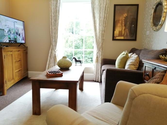 COSY LOUNGE WITH STUNNING VIEW OF THE IRON BRIDGE FROM THE SOFA