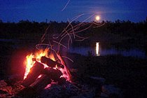 Watching the rising moon while sitting around the camp-fire can be a romantic way to spend an evening at the cottage.