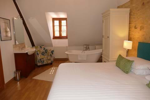 Bedroom 5 in Le Chataignier has its own free standing slipper bath and vanity unit