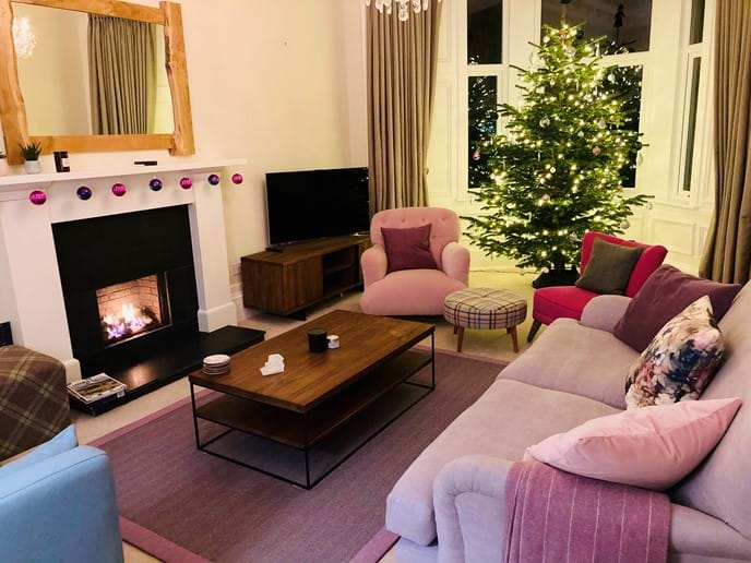 Lounge decorated for Christmas and New Year stays