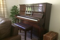 Guests are welcome to play the piano. A small selection of sheet music is provided.