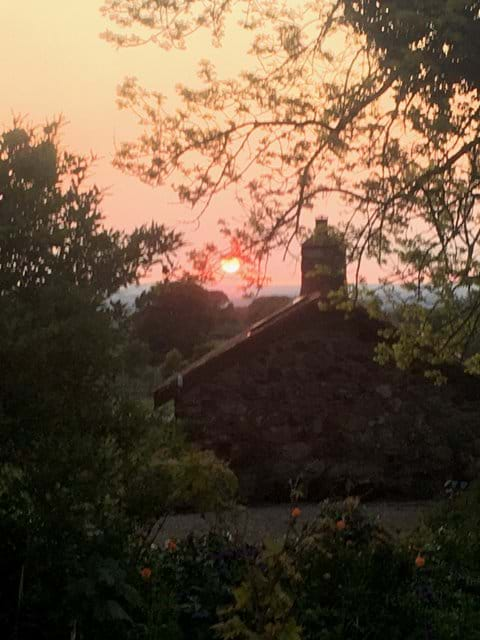 Sunset over the Bothy roof from the main house garden.