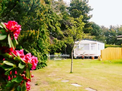 Holiday home is in a secluded area in the gardens