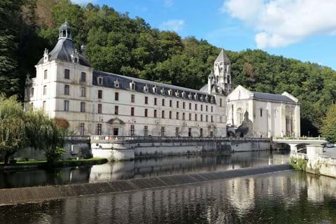 White Benedictine Abbey beside the river in Brantome