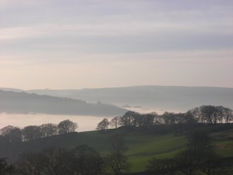 Early morning mist in the valley below