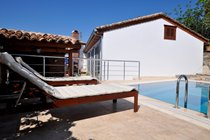 Pool side terrace with sun loungers