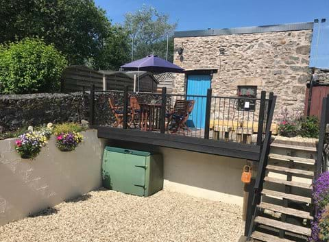 Two outside seating areas, raised mezzanine deck or sheltered stone barbecue area