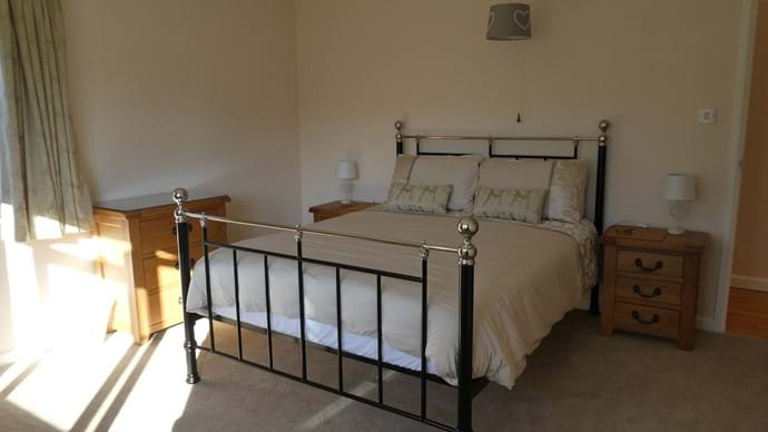 Master king size bedroom with dual aspect facing south overlooking the garden and view beyond