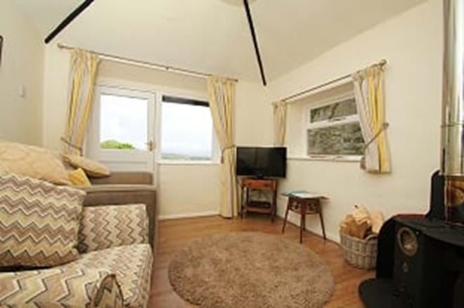 photo showing lounge area in holiday cottage near Criccieth with stunning views over lakes and mountains