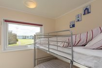 Second bedroom with space for cot or ready bed with fitted wardrobe