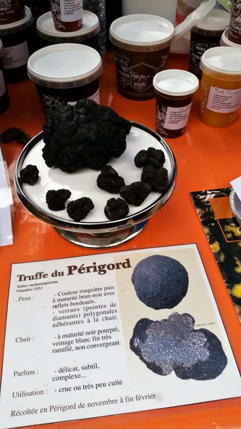 Perigord Black truffles of different sizes on a stall in Perigueux market