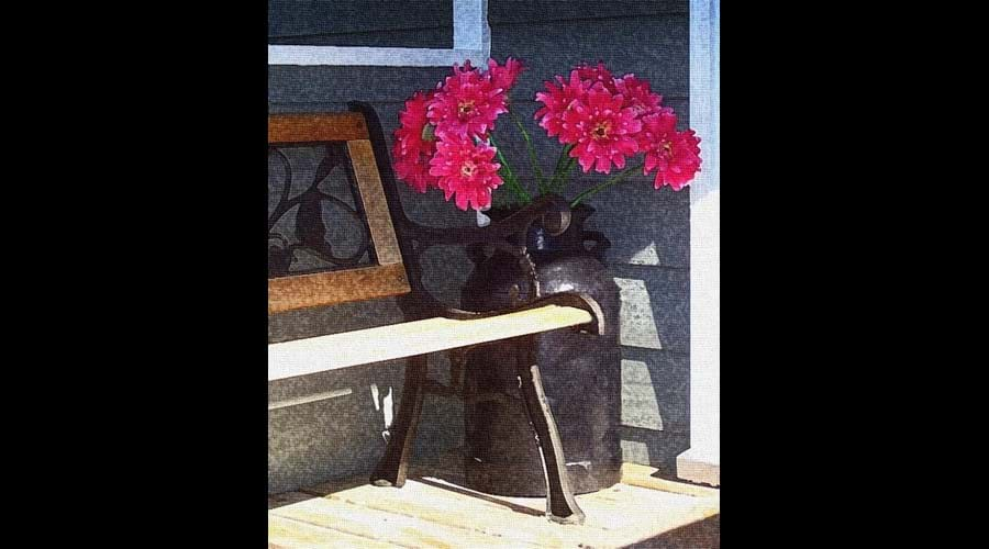 The covered back porch is a nice place to sit in the shade and relax.