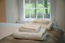 Luxury cotton linen and fluffy white towels are provided