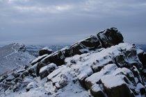 snow covered rocky ridge