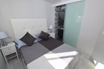 Guest bedroom with sliding door to ensuite
